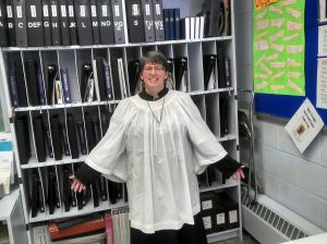 Sherrie McCleary-Small modeling our wonderful choir robes.